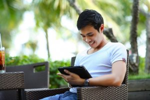 image of man using tablet