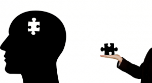 image of man holding puzzle piece