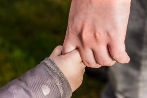 adult and babys hands holding