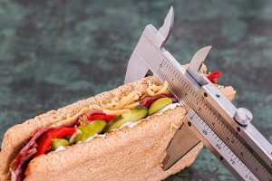 image of callipers measuring a hot dog
