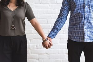image of man and wife holding hands