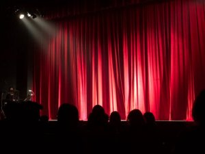 Image of an audience enjoy a magic show