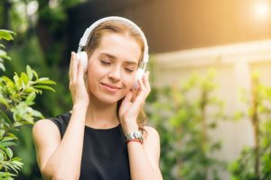 Image of a lady enjoying a soothing voice